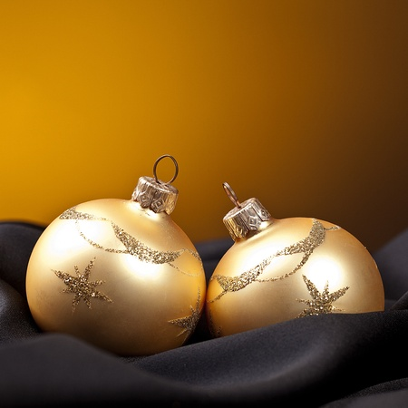 shafts: two golden christmas balls on black silk