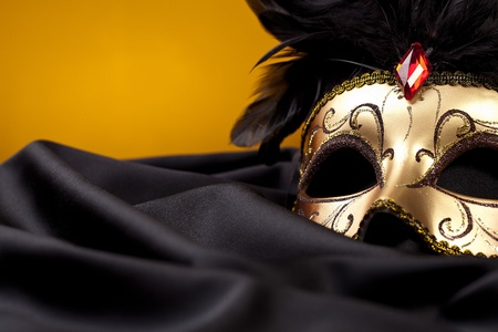 gold mask on black silk Stock Photo - 11337437