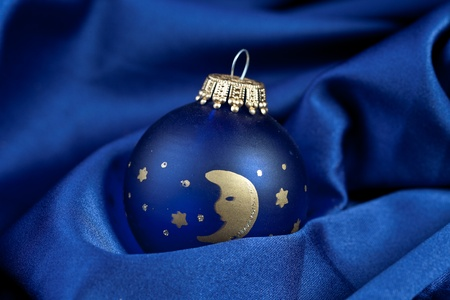 blue christmas ball on silk photo