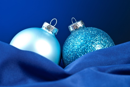 two blue christmas balls on silk Stock Photo - 11337523