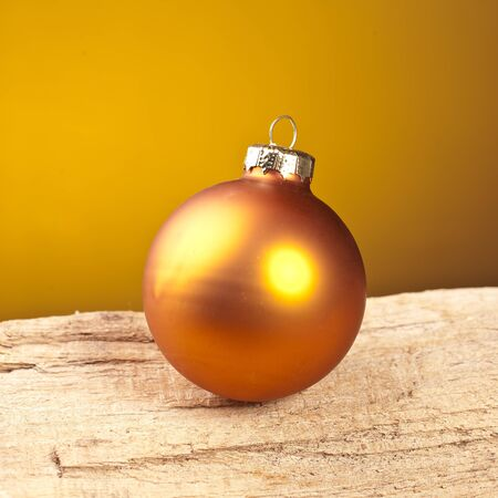 dene gold christmas ball aif wood Stock Photo - 11337792