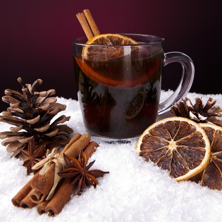 punch spice: glass of mulled wine with cinnamon, lemon and anise