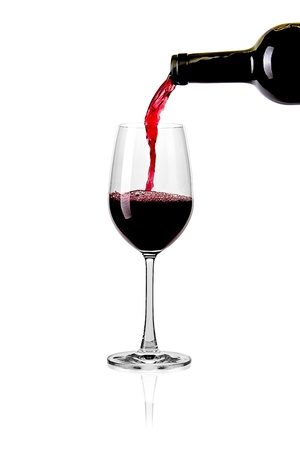 red wine pouring: Splash red wine glass against a white background Stock Photo