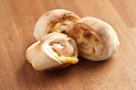 bread rolls: pizza rolls on wood Stock Photo