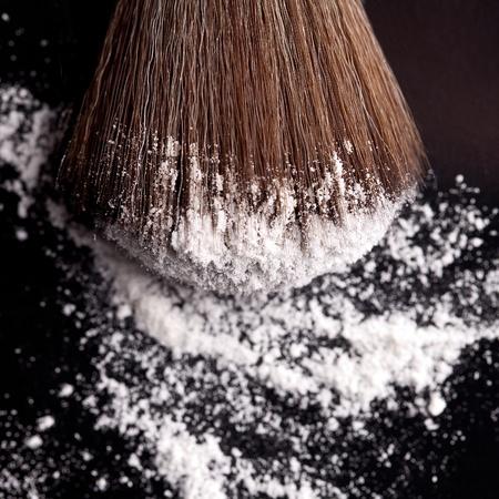 powderbrush on black background photo