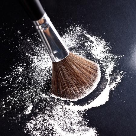 make up brushes: powderbrush on black background