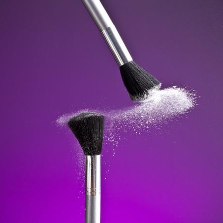 powderbrush on purple background Stock Photo - 11588377