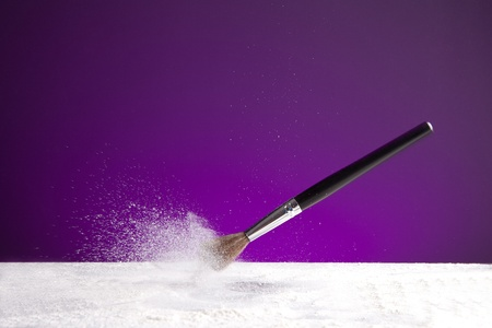 powderbrush on purple background Stock Photo - 11588428