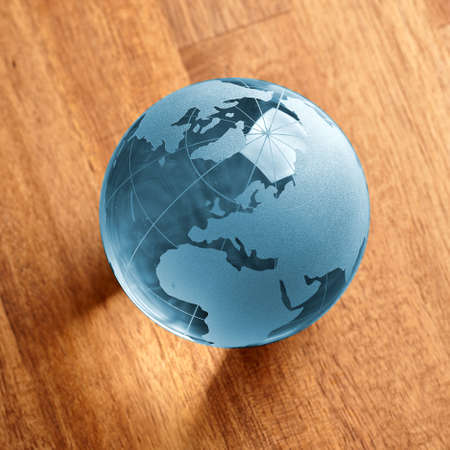 biologically: Blue Glass globe on wooden background