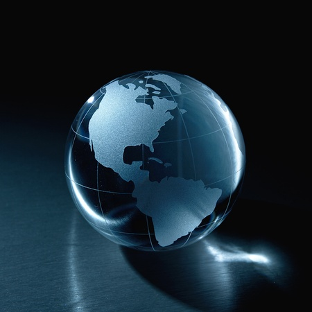Glass globe on a metal background photo