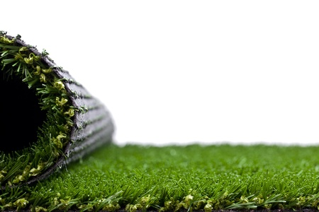 Green artificial turf rolled photo