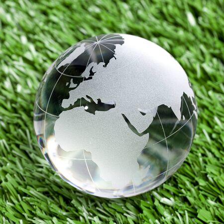 Glass globe on grass background