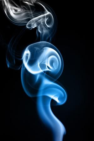 undulation: blue smoke forming waves on Black background Stock Photo