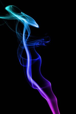 undulation:   multicolored smoke forming waves on Black background