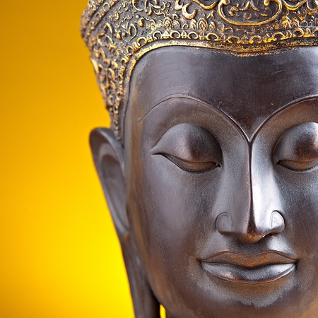 Buddha statue against golden background photo