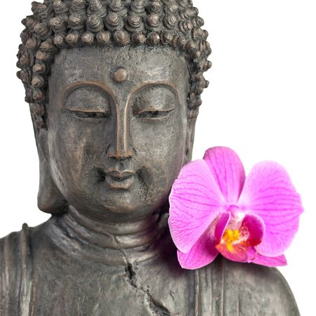 thai yoga: Buddha statue with orchid against white background Stock Photo