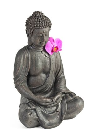 thai orchid: Buddha statue with orchid against white background Stock Photo