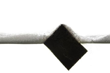 wetness: sponge in a Foam wave Stock Photo