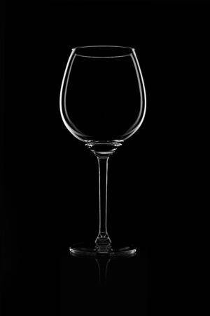 Red Wine Glas silhouette on Black Background photo