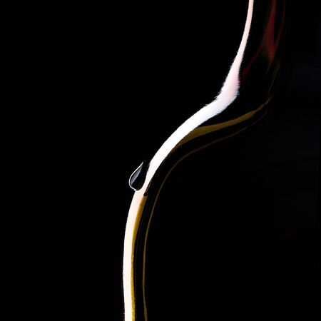 bottleneck silhouette with a drop on Black Background photo