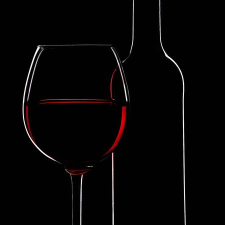 Red Wine Bottle silhouette and a Wine Glas on Black Background   photo