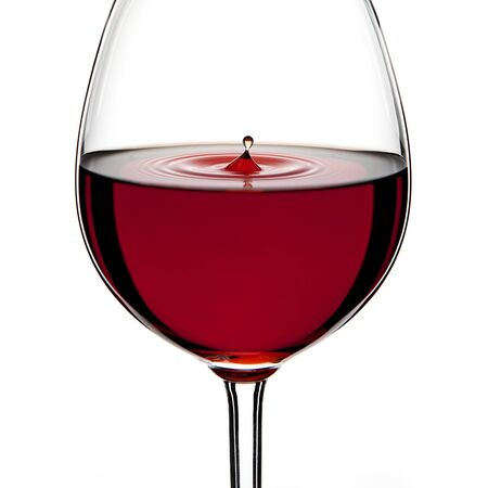 Red Wine Glas silhouette with a Drop on White Background photo