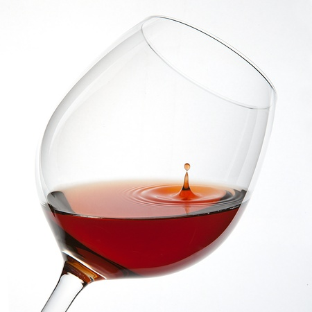 glas: Red Wine Glas silhouette with a Drop on White Background