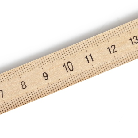 A wooden ruler on a white background photo