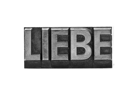 in liebe: lead letter word liebe on white background