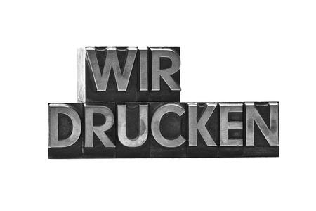 lead letter word wir drucken on white background photo