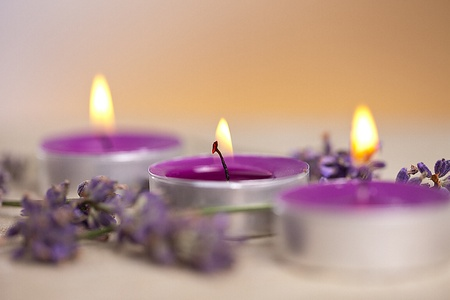 sense of security: candel with flamme with lavender Stock Photo