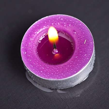 candel with flamme on water Stock Photo - 12508236