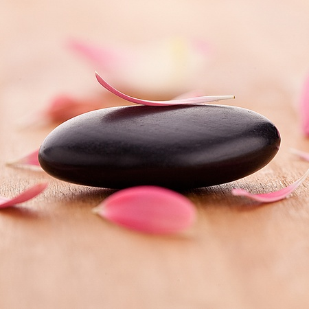 repelling: black stones with leaves Stock Photo