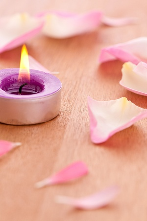roseleaf: Rose leafs with candel on wooden background