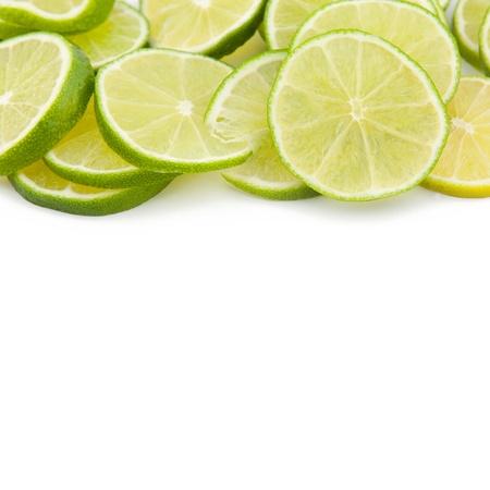 limonene:   Green limes discs Fruit Cocktail on white backgorund Stock Photo