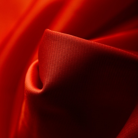 polyester: Red silk cloth with fold litter