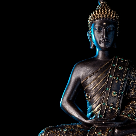 wellness center: Buddha statue with Blue glow  Stock Photo
