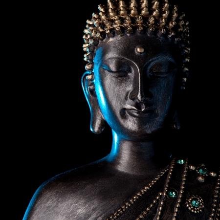 stone buddha: Buddha statue with Blue glow  Stock Photo