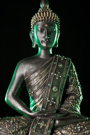 stone buddha: Buddha statue with green glow