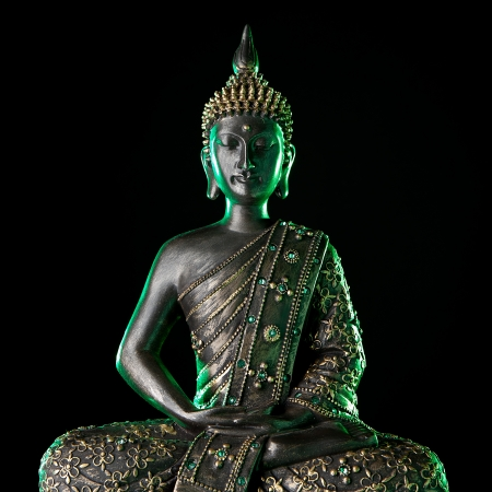 Buddha statue with green glow  photo
