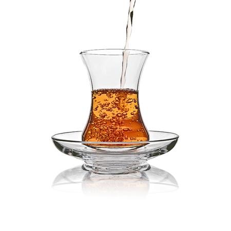 sufficient: Turkish tea glass splash in sufficient amount on white background Stock Photo