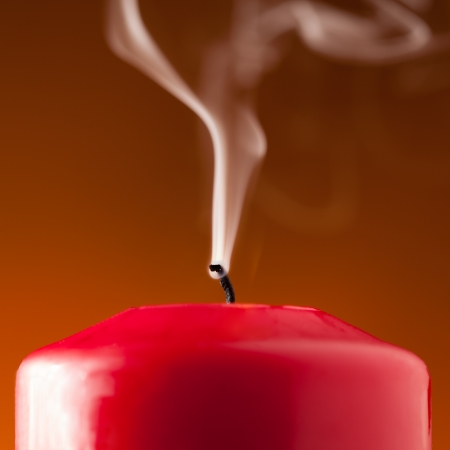 decode: candle lit smoke flame candlelight candlestick smoldering fire advent christmas time religion   Stock Photo