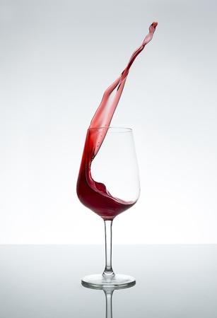 wine trade: Red wine glass splash stilllife bottle alcohol beverage liquor merlot wine trade