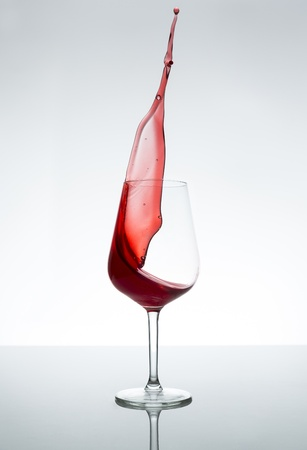 Red wine glass splash stilllife bottle alcohol beverage liquor merlot wine trade photo