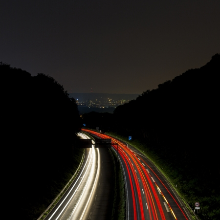 long time exposure freeway cruising car light trails streaks of light speed highway Aix-la-Chapelle Stock Photo