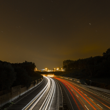 long time exposure freeway cruising car light trails streaks of light speed highway Aix-la-Chapelle photo