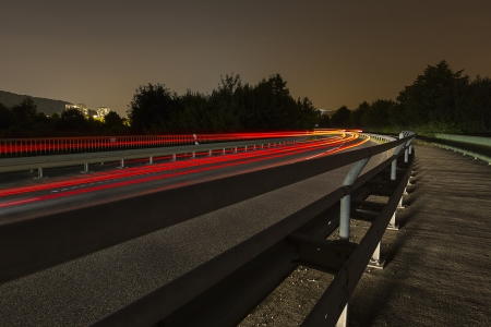 off track: long time exposure freeway cruising car light trails streaks of light speed highway Aix-la-Chapelle Stock Photo