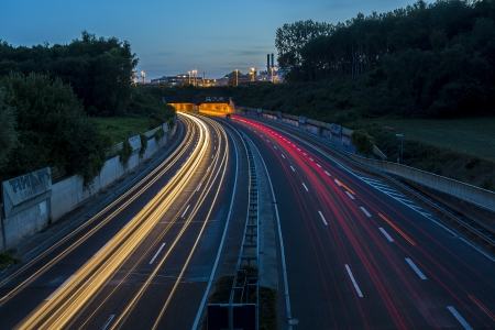 long time exposure freeway cruising car light trails streaks of light speed highway bridge photo