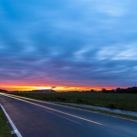 sunrise clouds long exposure car car sunlight dusk red sky blue hour photo