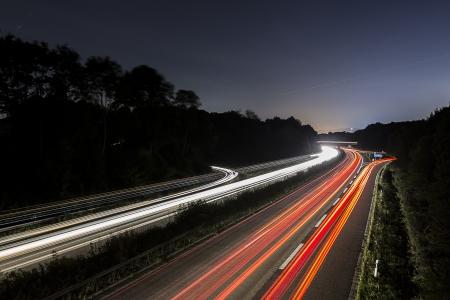 moon light: long time exposure freeway moon cruising car light trails streaks of light speed highway